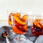 Chilled peaches in white wine
