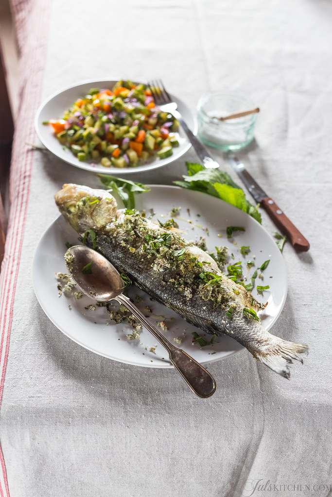 Baked sea bass with fresh herbs from the garden